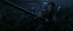 Thor exerting his strength to move the rings of Nidavellir