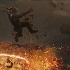 Thanos a punto de lanzarle un rayo a Strange.