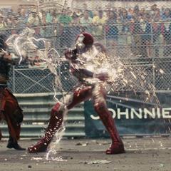 Stark logra inmovilizar a Vanko y detenerlo.