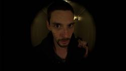 Jigsaw-LookingAtTheDoorhole