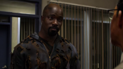 Luke Cage talking with police captain