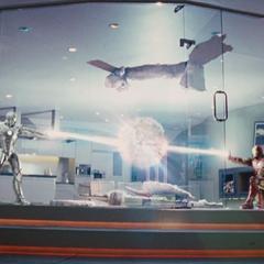 Rhodes y Stark a punto de hacer que la habitación explote.