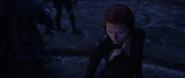 Black Widow looks at cliff