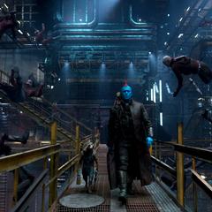 Rocket y Yondu caminan mientras los Devastadores caen vencidos.