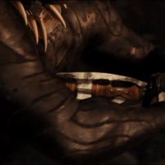 N'Jadaka se quita la lanza del pecho para morir.