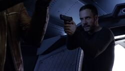 Lance-Hunter-aims-gun-at-Ward