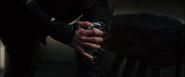 Hawkeye putting on his arrow case