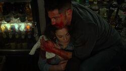 Frank saving Beth