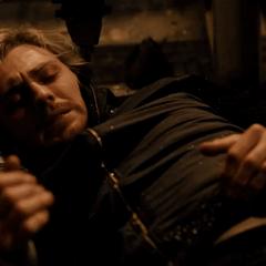 Pietro es inmovilizado por Barton.