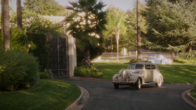 File:Peggy pulls up to the Stark Estate (2x08).png