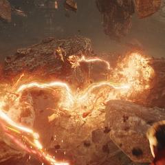 Thanos recibe un ataque de Strange.