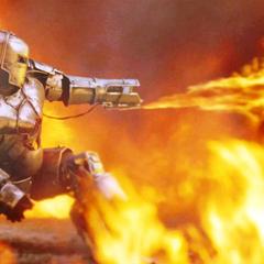 Stark dispara el lanzallamas contras sus atacantes.