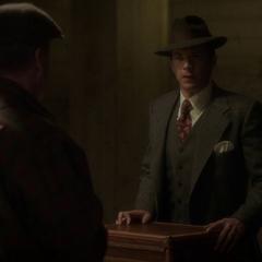 Jarvis negociando con los secuaces de Mink.
