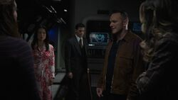 Coulson briefs the team on what he knows