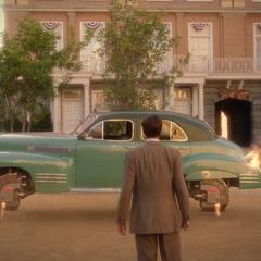 Jarvis envía el auto volador hacia la grieta.