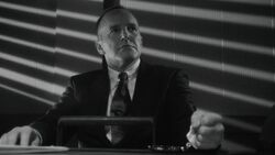Coulson handcuffed to a table