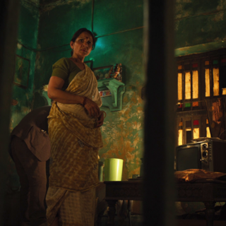Rashmi Rustagi como Mujer de Calcuta