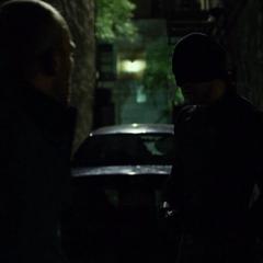 Murdock cuestionando a John Healy.