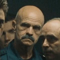 Paul Grace como Guardía de prisión francés #1