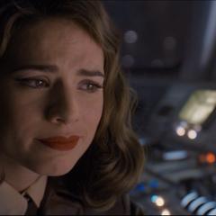 Carter llora por la supuesta muerte de Rogers.