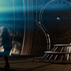 Thor and Jane exit the bridge on Asgard.