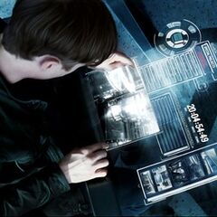 Harry Osborn watching footage of Electro's transformation.