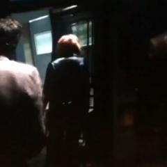 Natasha escorting Bruce Banner and Steve Rogers onto the bridge