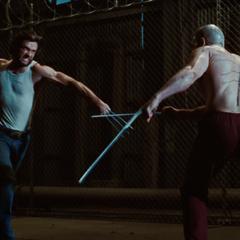 Wolverine attacks Deadpool