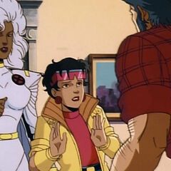 Ororo tries to calm an agitated Logan down with Jubilee.