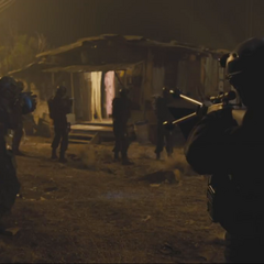 SHIELD Agents surrounding Banner in a shack.