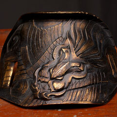 Loki's armor, depicting the Snake of Midgard.