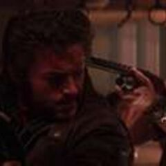 Albert with his gun on Wolverine.