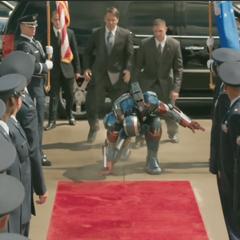 Eric Savin in the Iron Patriot armor.
