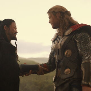 Hogun and Thor shake hands after the battle.