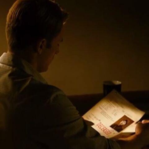 Steve Rogers reading Jim Morita's file.
