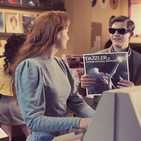 Scott and Jean finds Dazzler's album, <i>Sounds of Light and Fury</i>.
