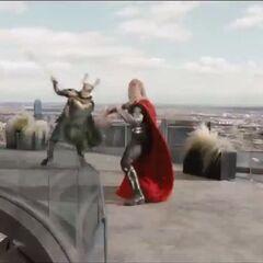 Thor fighting Loki on top of Stark Tower.
