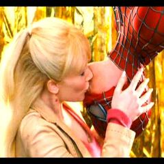 Gwen giving Spider-Man a kiss of appreciation