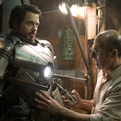 Tony donning his first armor with the assistance of Yinsen.