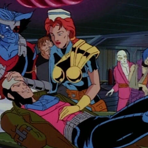 Jean Grey tends to the wounded.