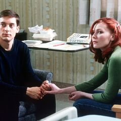 Peter & MJ hold hands at the hospital.