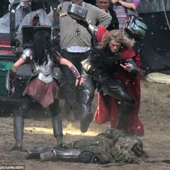 Jaimie Alexander and Chris Hemsworth on set as Sif and Thor.