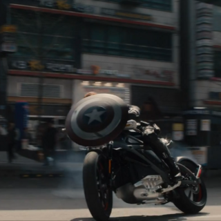 Cap's shield on the front of Widow's bike