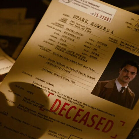 Steve reading Stark's file, learning the details of his death.