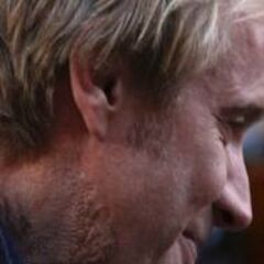 A photo taken on set of Rhys Ifans with scaly make-up on his neck.