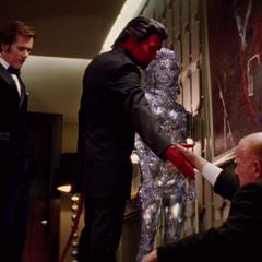 Riptide, Sebastian Shaw, and Emma Frost watch as Azazel teleports Hendry