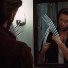 Logan inspects his new adamantium claw