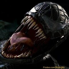 Venom roaring, showing off his signature slimy tongue