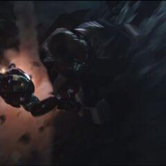 Thor and Iron Man fighting.