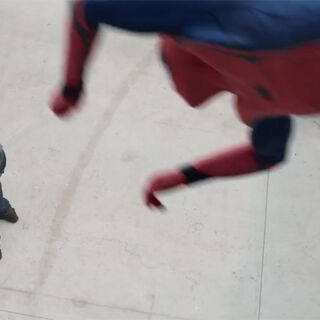 Spider-Man using his web-shooters to grab <a href=